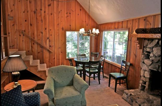 Family room with knotty pine wood siding