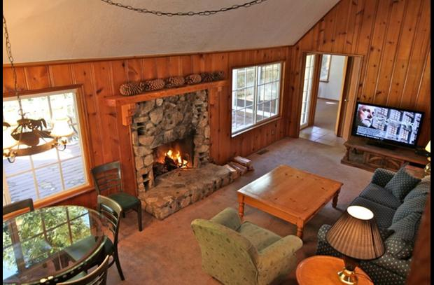 Family room with wood burning rock fireplace