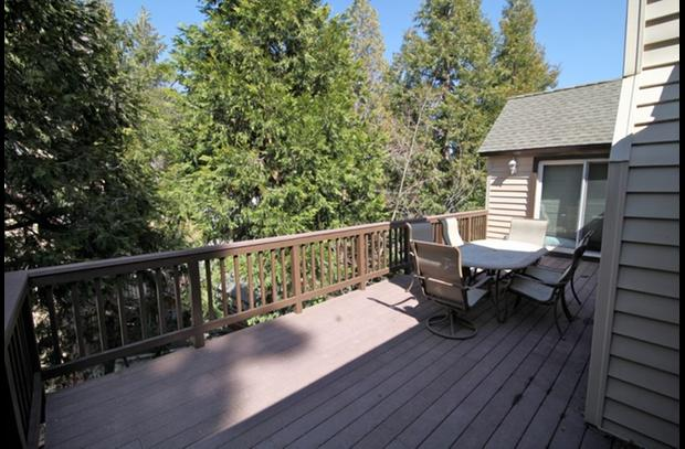 Large deck surrounded by trees