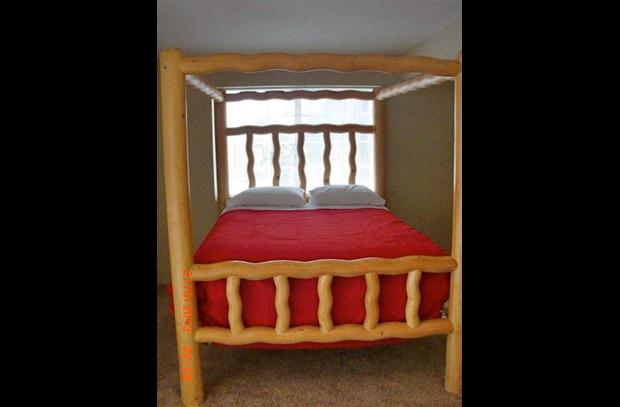 Custom made knotty pine bed with queen mattress