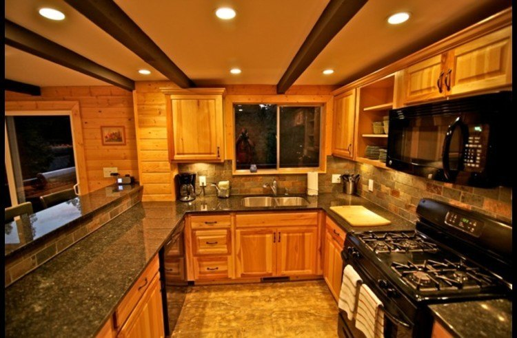 Kitchen with black granite counters and slate backsplash