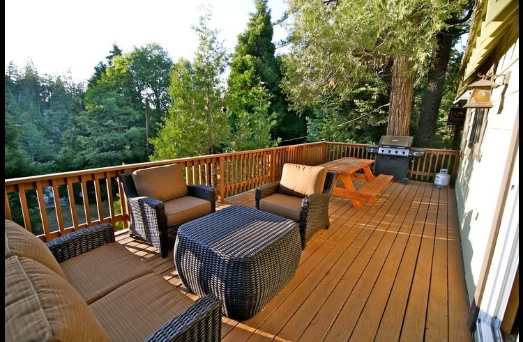 Large deck with lounge area, picnic table and BBQ