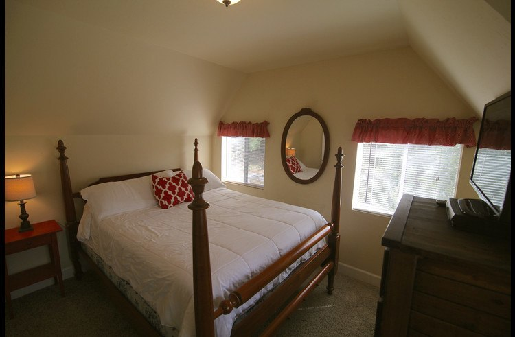 Master bedroom with queen bed on upper level