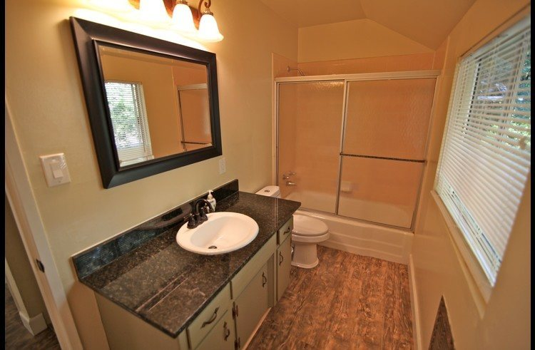 Bathroom on upper level with granite counter top