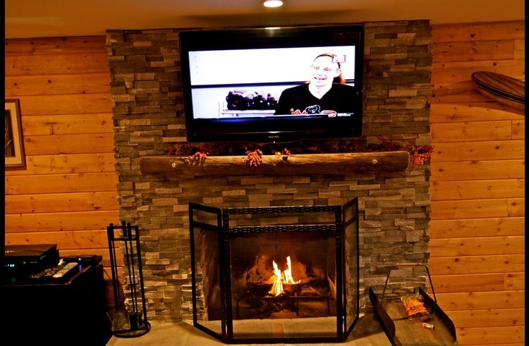 Ledger stacked stone fireplace with flat screen TV