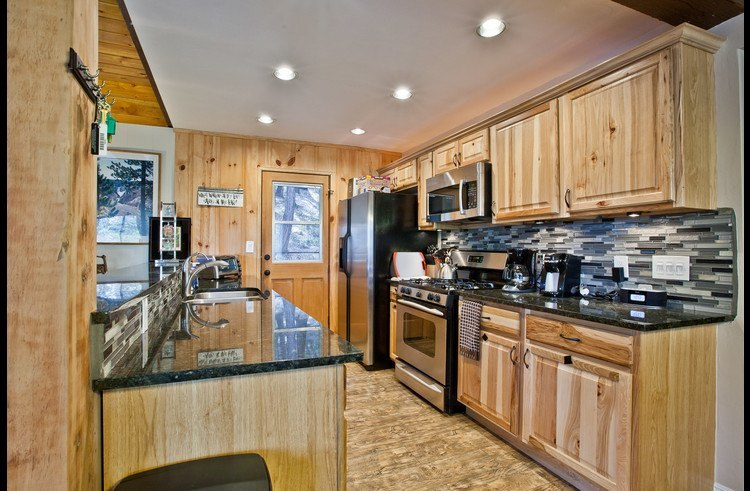 Granite counters throughout and stainless steel appliances