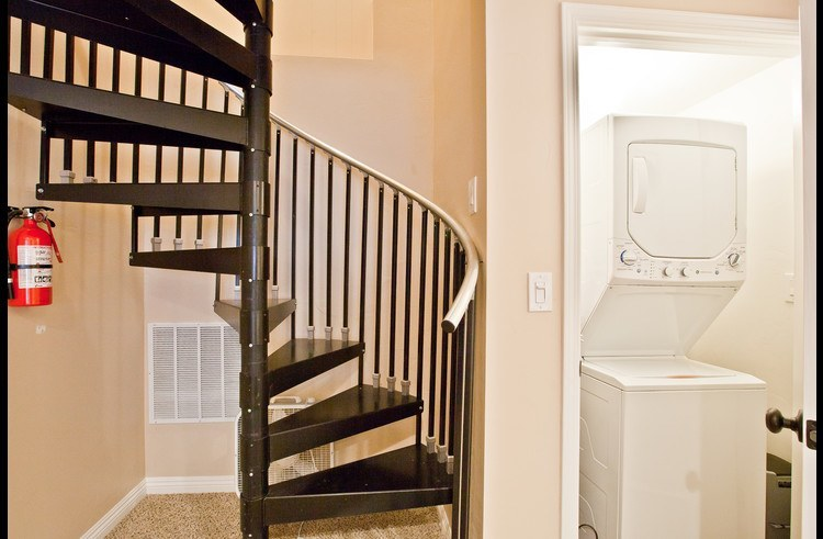Spiral staircase with laundry closet
