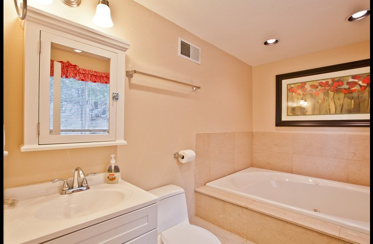 Master bathroom with with an oversized bathtub