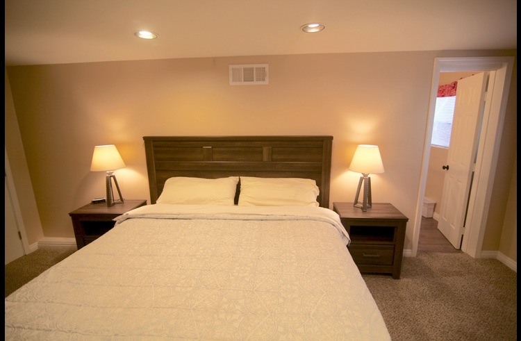 Master bedroom with king bed and attached bathroom