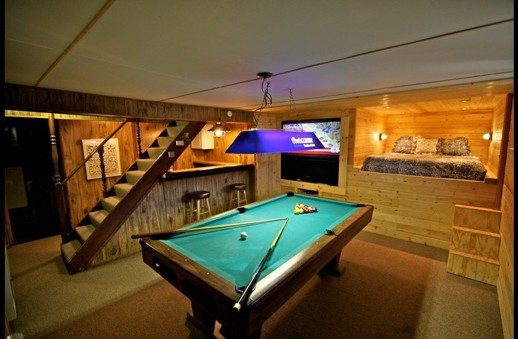 Pool table with bar under the stairs