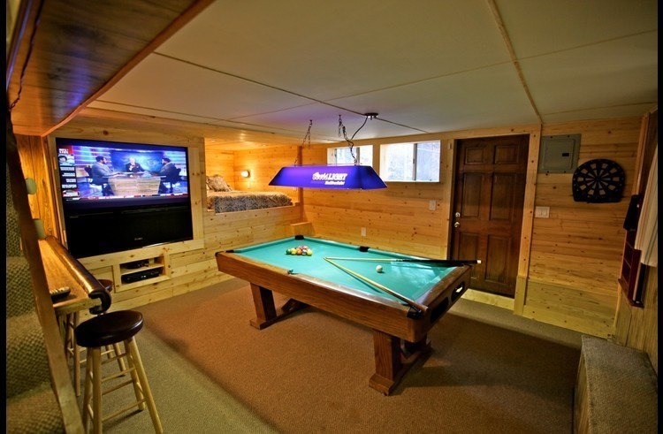 Lower level - game room with bar and built-in bed
