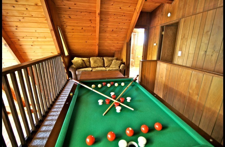 Loft with pull-out sofa bed and bumper pool table
