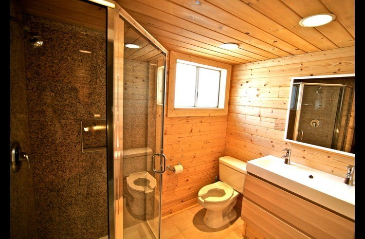 Bathroom on upper level with granite shower