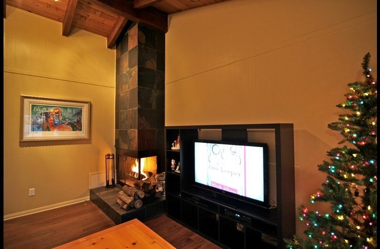 Flat screen and wood burning fireplace in family room