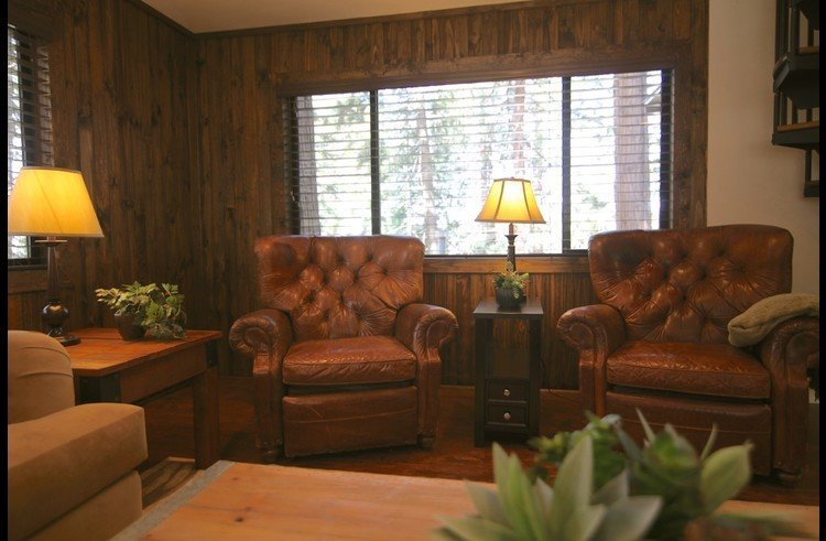 Family room with knotty pine walls