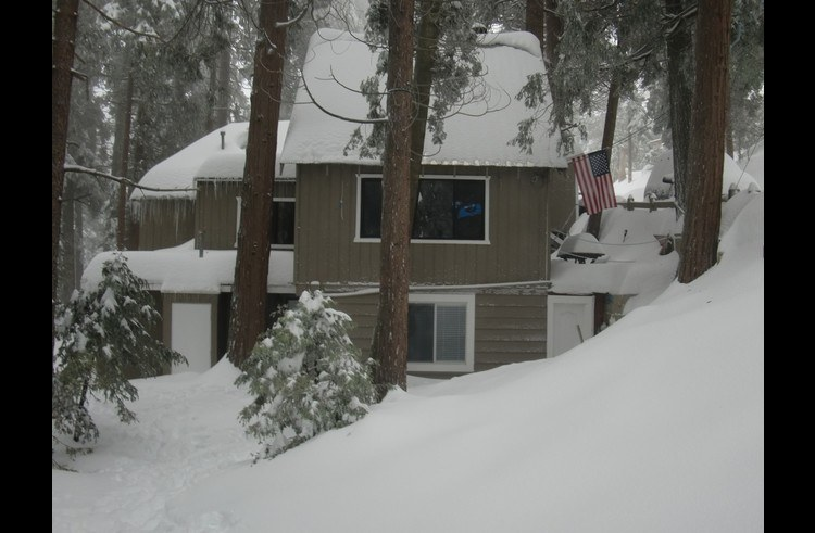 Side view of the Lodge after a large winter storm
