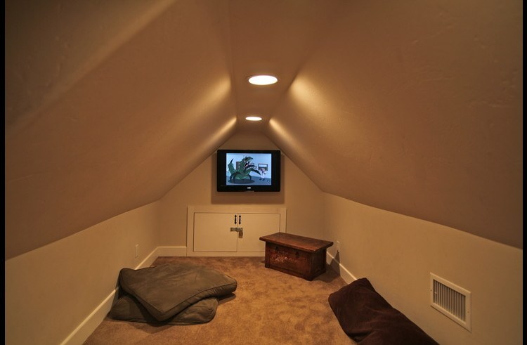 Secret kids hide-away with flat screen TV, bean bags and pillows for kids to escape on the upper level