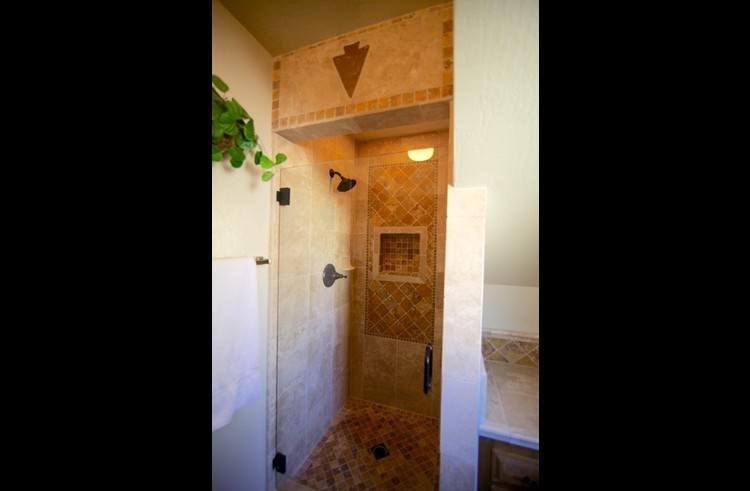 Bathroom on middle level with custom stone shower