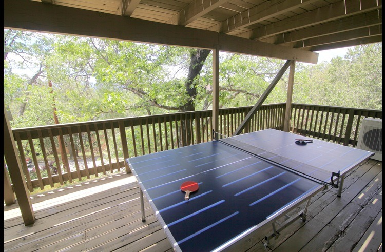 Deck on middle level with ping pong table