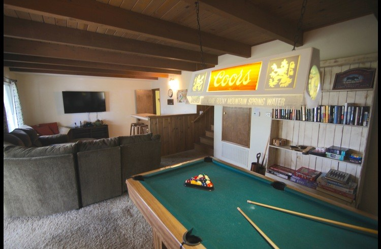 Pool table, 60 inch flat screen, wet bar and sectional sofa