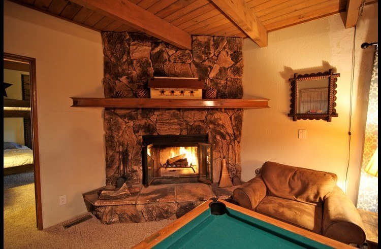 Wood burning fireplace in game room