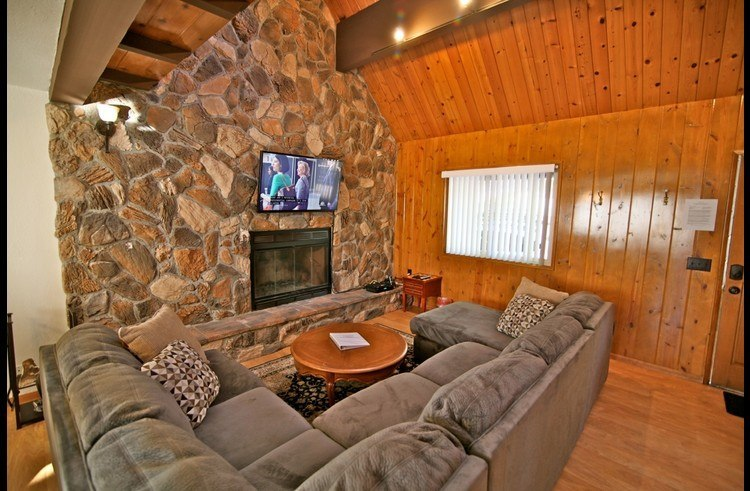 Floor to ceiling rock surrounding the wood burning fireplace