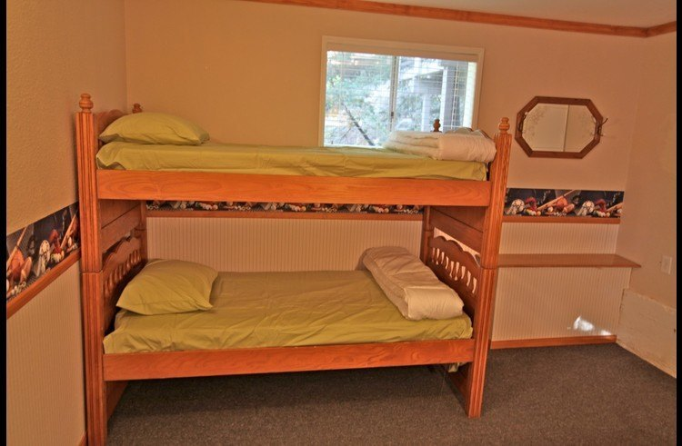Twin bunk beds in the lower level bedroom / game room