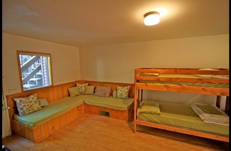 L-shaped lounge area next to bunk beds - great for kids