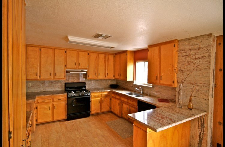 Large kitchen with granite counter tops