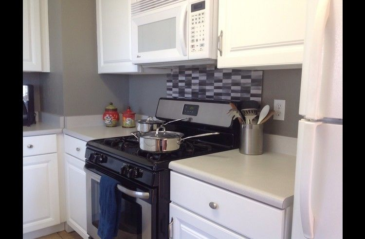 Kitchen with stainless steel/black oven