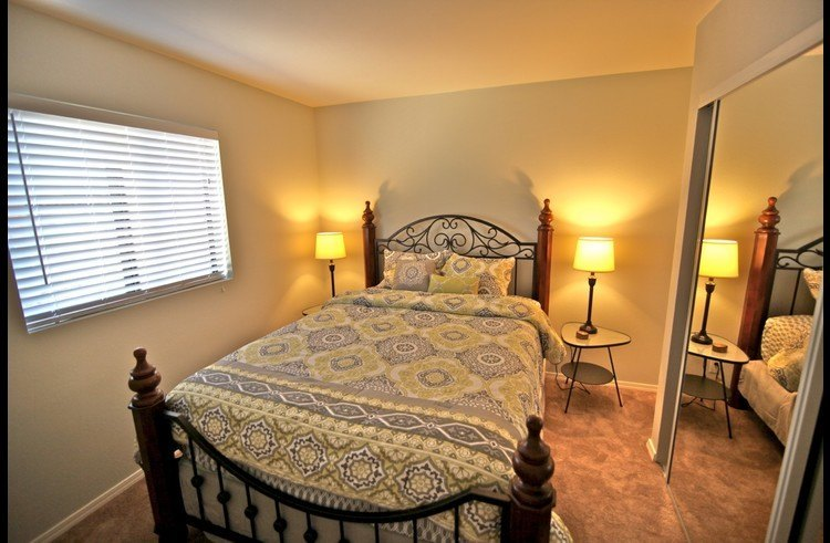 Guest room on main level with queen bed
