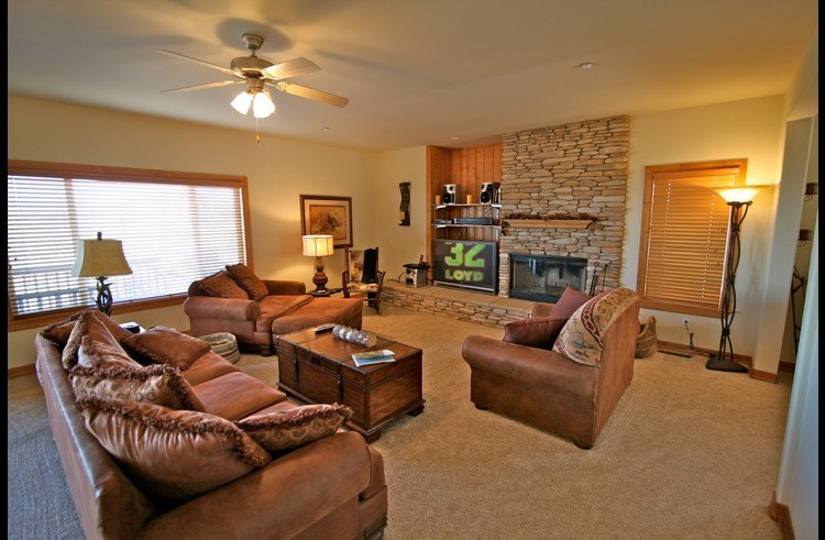 Family room with wood burning fireplace and flat screen TV