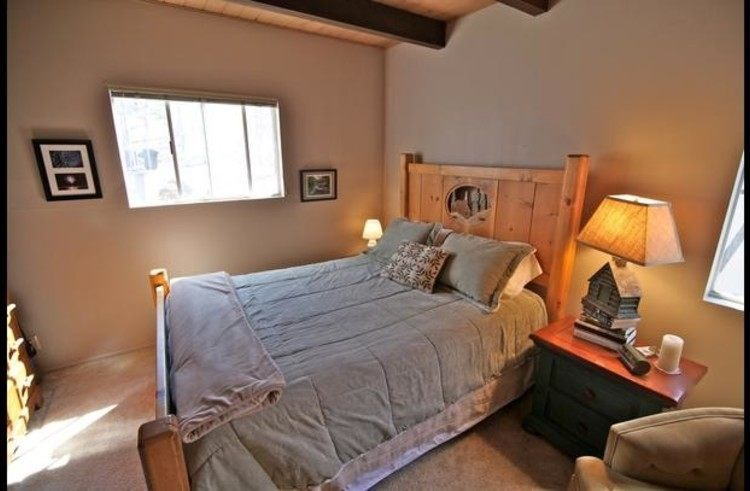 Guest room 1 on main level with queen bed