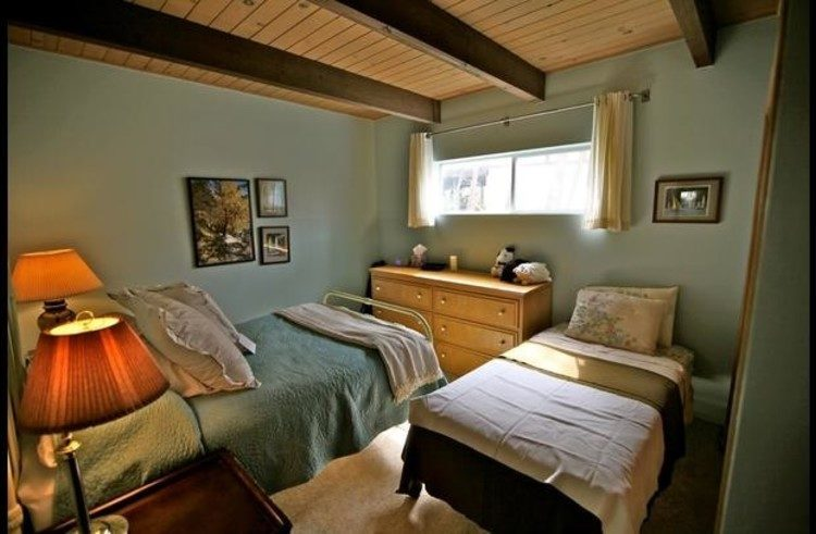 Guest room 3 on lower level with full size bed and a twin size trundle