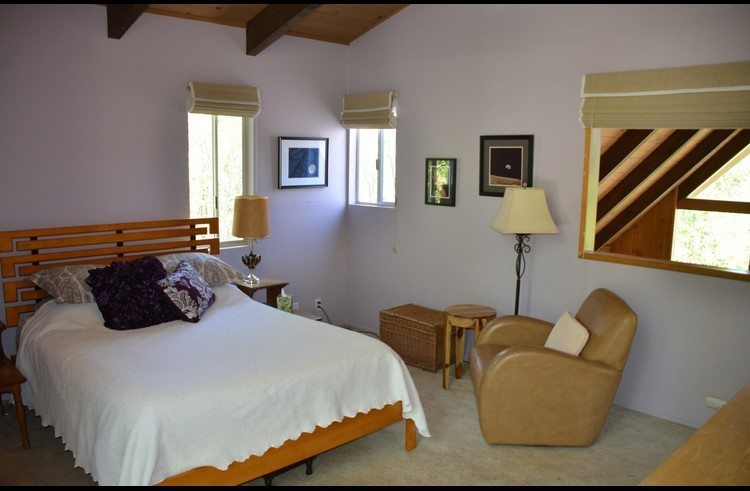 Master bedroom on upper level with queen bed