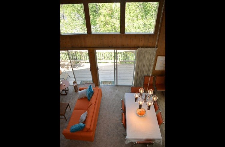 View of dining area and living room from the upper level