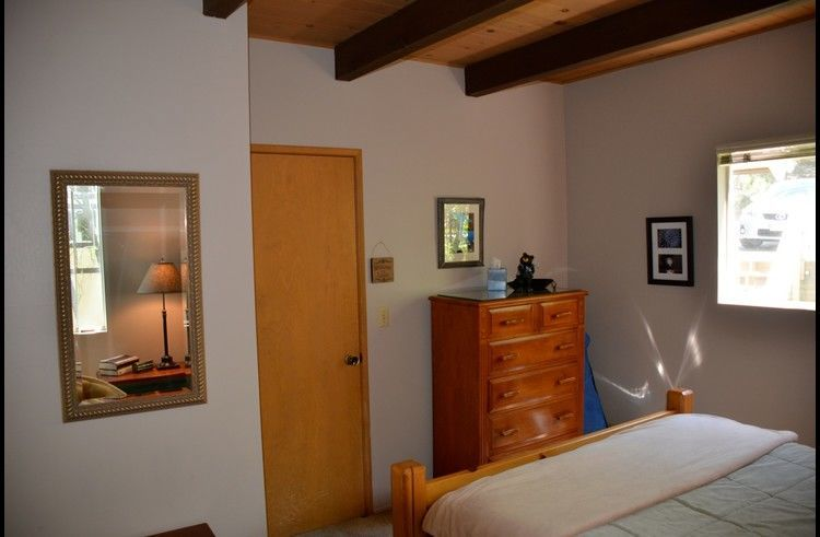 Guest room 1 on lower level with queen bed
