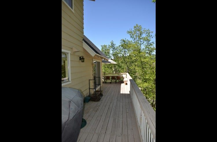 Deck on side of the lodge with BBQ