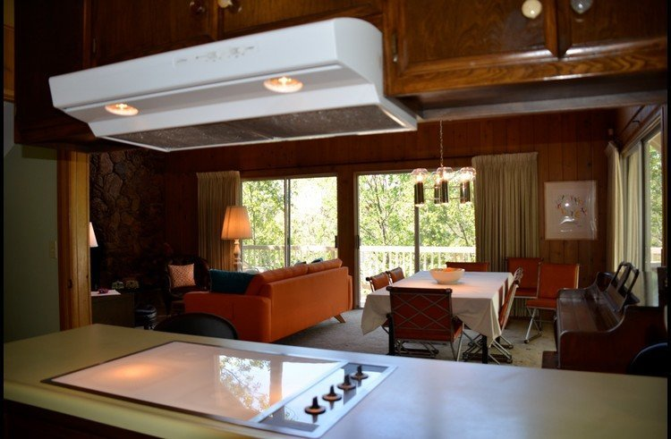 View of dining area and living room from the kitchen