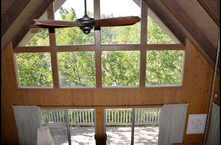 View from the loft of the classic A frame architecture with tons of natural light