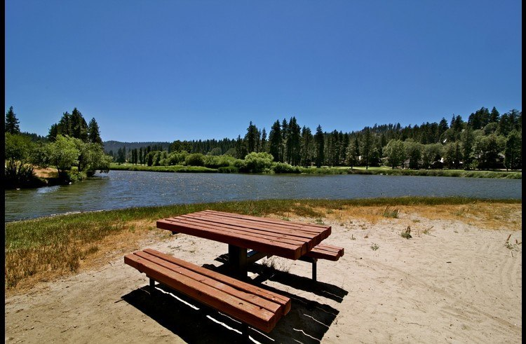 Picnic table with views of the lake and Lake Arrowhead Country Club's golf course
