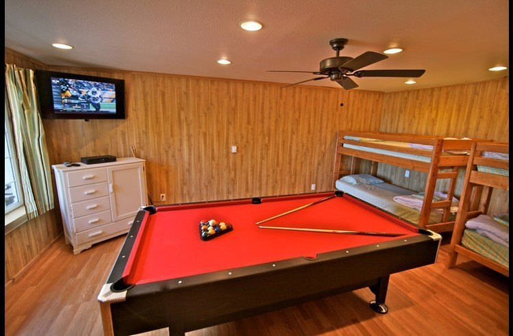 Game room with flat screen TV and pool table
