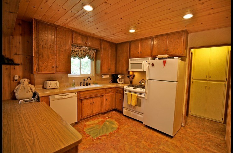 Kitchen with knotty pine ceilings and recessed lighting